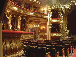 The fabulous set of the Paris Opera House for 'Phantom of the Opera' - 2004. This was built as a fully-operational theatre  capable of holding a substantial audience in the auditorium, an orchestra and a full cast of artistes on stage. The construction used two adjoining stages at Pinewood Studios so that the action from  the theatre stage could follow right through the authentic  backstage area built on two floors, complete with dressing  rooms, costume department, props store etc, to the stage  door exit complete with  stables.